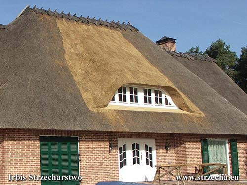 Thatch - modernization of the house often makes alterations to the roof surface - here resizing windows with wooden structure reworking