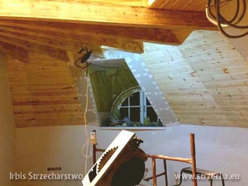 Finishing the roof insulation with wood and gypsum boards