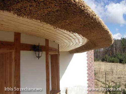 Thatch: finished soffit, wall stylized as half-timbered also