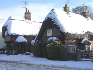 Straw roofs on the buildings of the English province, in winter